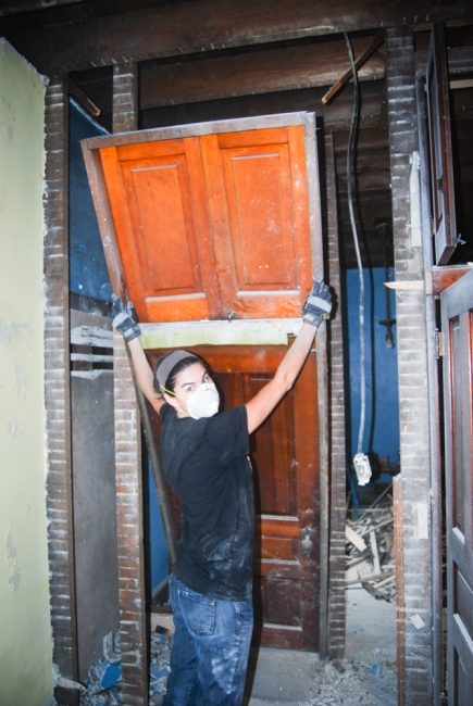 Removing the door and jamb to salvage for another location in the house