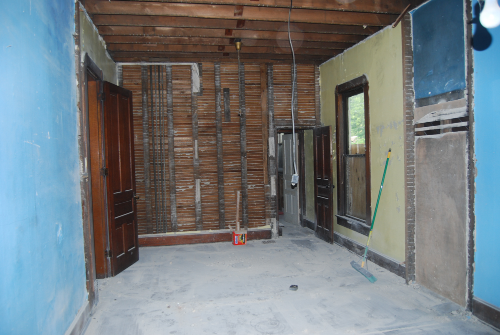 View of bathroom space, stair case area, and part of the playroom after closets were removed
