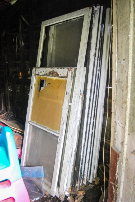 Storm windows just waiting for us in the shed