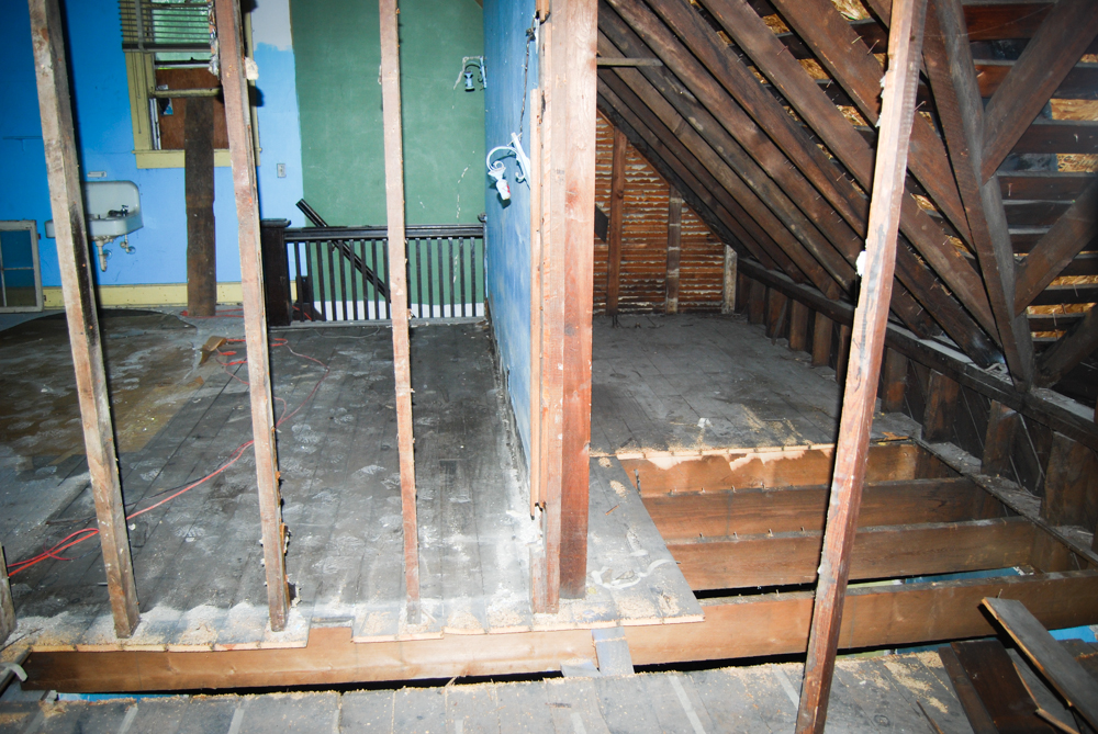 Some of the floor removed to help us layout the upstairs and downstairs bathrooms.