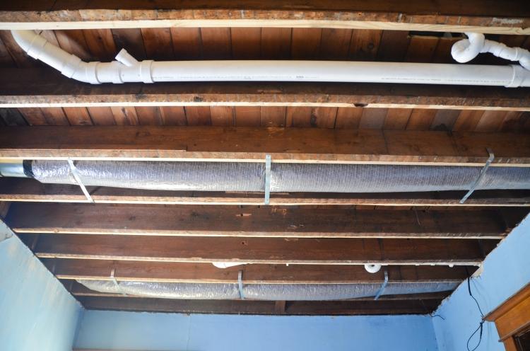 duct work and plumbing in the floor joists