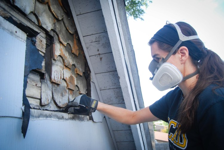 removing asbestos siding from the front of the house