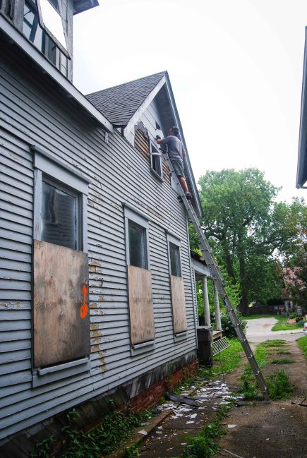 Removing siding from the north gable