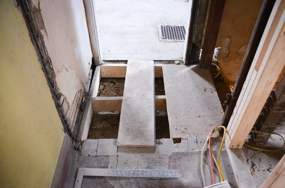 Top of the basement stairs after inserting new floor joists