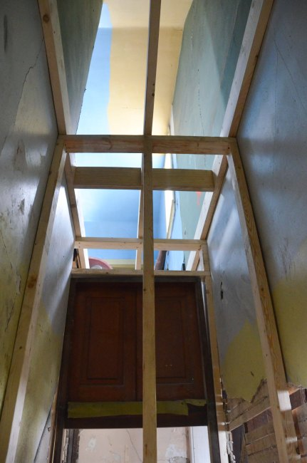 Standing at the bottom of the old stairs looking through the closet wall and up to master bedroom