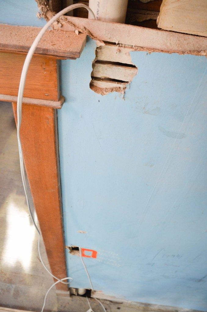 A hole near the floor, a hole near the switch plate and a hole near the ceiling. Perfect.