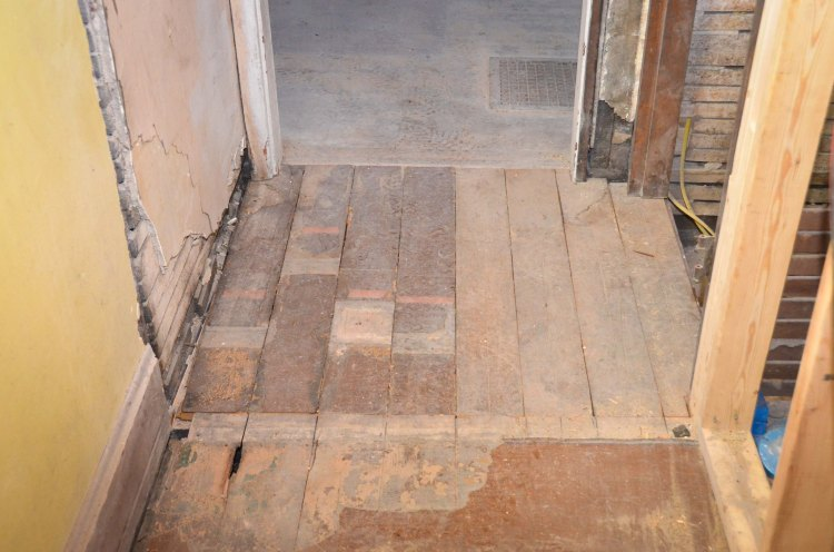 New floor at the top of the basement stairs