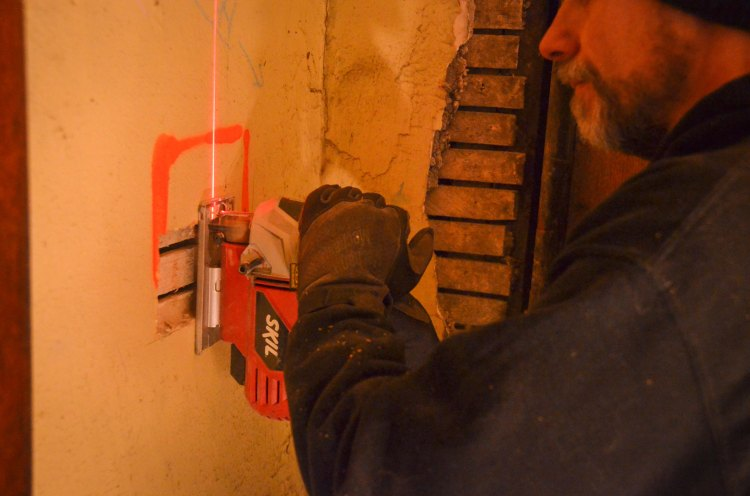 cutting a hole for a new electrical box location
