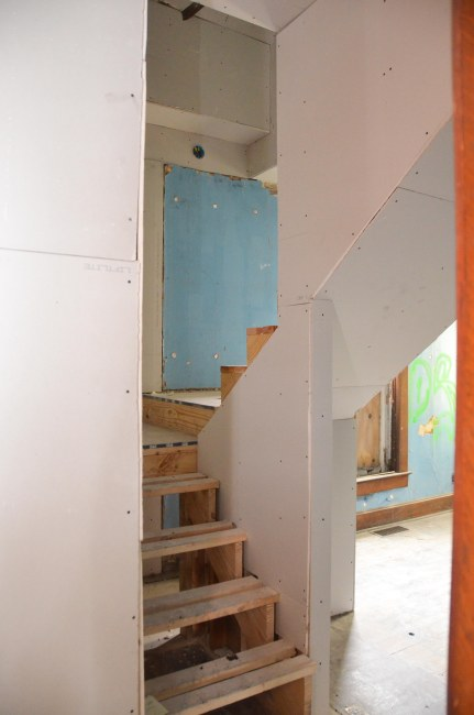 The view of the stairs from the dining room doorway