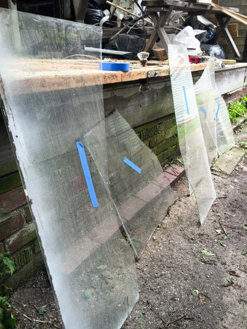 labeling the old glass to be used for the storm doors