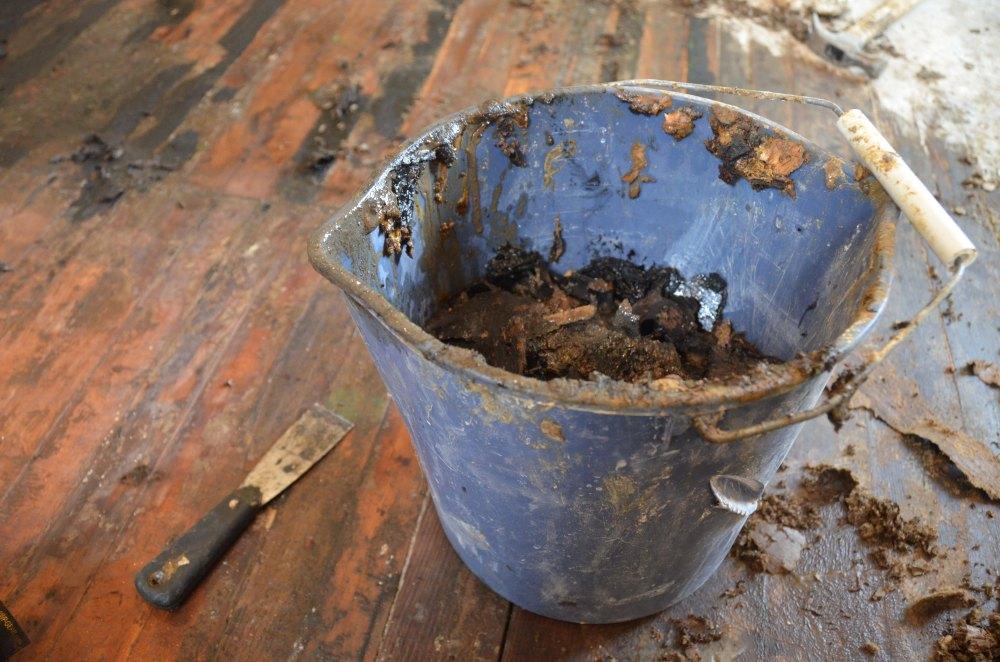 Bucket of mastic tar