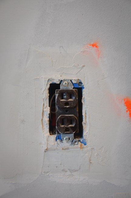 Using new plaster to snug in any loose outlets